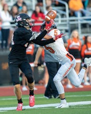 Pinckney's Caleb Wardlow (left) leads Livingston County with 20 catches and 393 receiving yards.