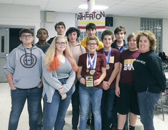 Teacher Erin Schneider, a recipient of a Presidential Award for Excellence in Mathematics and Science Teaching, with Atherton High School students.