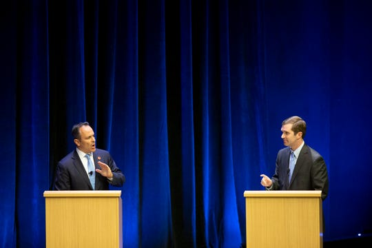 Republican Gov. Matt Bevin, left, and Democratic Attorney General Andy Beshear participate in a debate at the Singletary Center for the Arts on the University of Kentucky campus in Lexington, Ky., Tuesday, Oct. 15, 2019. (Ryan C. Hermens/Lexington Herald-Leader via AP, Pool)