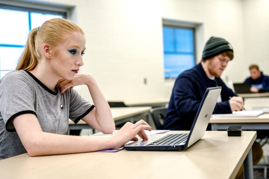 Eastern Flex Academy student Nikova Aldrich, 17, works on the computer in class on Wednesday, Oct. 16, 2019, at Eastern High School in Lansing. Eastern Flex allows students to take classes after the traditional school day allowing for jobs, college courses or caring for family at home before coming to school.