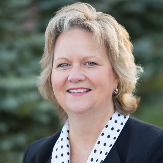 Beth Graham was also recognized at the state level, earning the same title from the Michigan REALTORS® at The Convention in Detroit in early October.