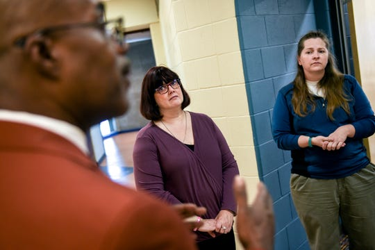 Eastern Flex Academy coordinator and English teacher Dee Halstead, center, and Flex math instructor Candy Hayden, right, look on as principal Marcelle Carruthers talks about the new program on Wednesday, Oct. 16, 2019, at Eastern High School in Lansing. Eastern Flex allows students to take classes after the traditional school day allowing for jobs, college courses or caring for family at home before coming to school.