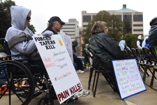 A group of about 30 people gathered to protest at the Don't Punish Pain rally at the Capitol Wednesday, Oct. 16, 2019.