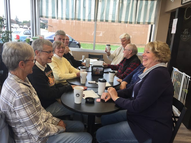 A group of people enjoys coffee and conversation at Cup & Cone in Lexington.