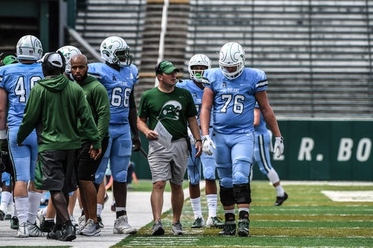 Tulane offensive coordinator Will Hall, center, will return to Memphis where he spent last season as associate head coach/tight ends coach.