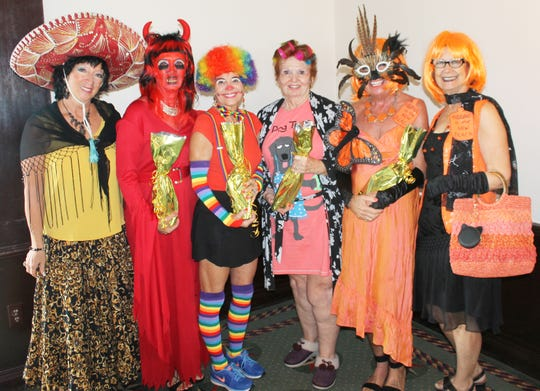 President Rose Kraemer congratulates best costume winners; scariest, Candy Seward; funniest, Pam Brink; most original, Trisha Pease; best all around, Jan Cirillo and JoAnn Brandau.