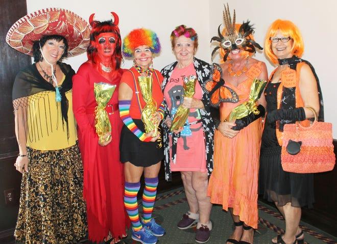 President Rose Kraemer congratulates best costume winners; scariest, Candy Seward; funniest, Pam Brink; most original, Trisha Pease; best all around, Jan Cirillo and JoAnn Brandau.