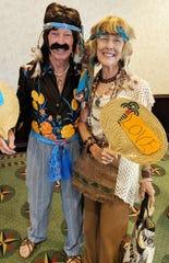 MIYC members Alan and Linda Sandlin won an award for their outstanding Woodstock 50th Anniversarycostumes.