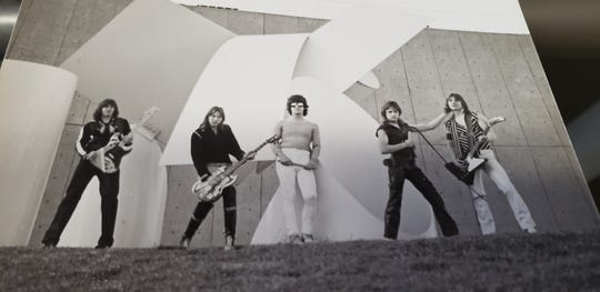 Robert Feest, now the owner of an insurance agency, used to be in the heavy metal band Tease, from 1979-83. Feest is pictured fourth from left in this photo.