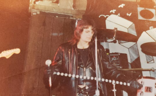 Robert Feest gets ready to perform as a member of the heavy metal band Tease. The band performed in the Milwaukee area from 1979-83.