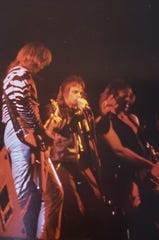 Robert Feest (center) sings during a show. The owner of Robert J Feest & Associates in Elm Grove  used to be a member of the metal band Tease in the Milwaukee area from 1979-83.
