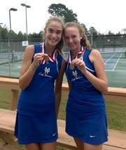 Mountain Home's Macie Heide (left) and Sarah Godfrey show their state championship medals after winning the Class 5A doubles title on Tuesday in Hot Springs.