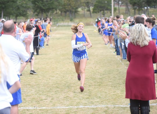 Mountain Home's Marcie Cudworth crosses the finish line to win the Bomber Invitational on Tuesday.