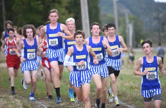 Mountain Home's Xander Towne (from left), Bob Allen, Whit Lawrence, Andrew Westphal, Jacob Pyeatt, Riley Rowden and Ky Bickford lead the pack during the varsity boys' race of the Bomber Invitational on Tuesday at MHHS.