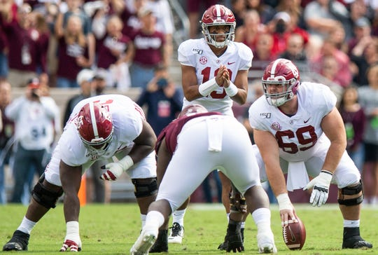 Alabama offensive linemen Deonte Brown (65) and Landon Dickerson (69) line up in front of quarterback Tua Tagovailoa (13) against Texas A&M at Kyle Field in College Station, Texas on Saturday October 12, 2019.