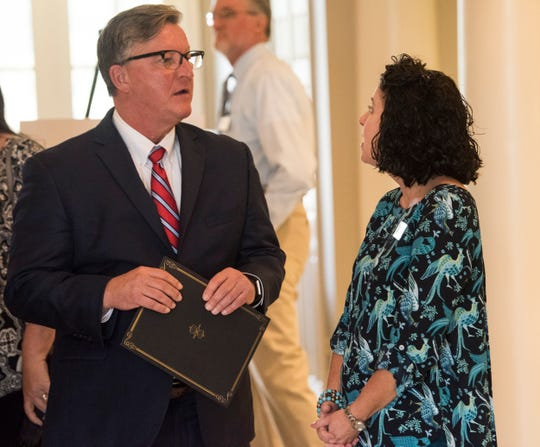 Chamber's economic development director Woody Hydrick, left, speaks with city council member Lora Lee Boone at the Prattville Area Chamber of Commerce in Prattville, Ala., on Wednesday, Oct. 16, 2019. Local officials declared proclamations naming this week chamber of commerce week.