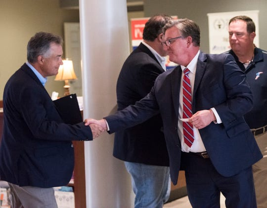 Prattville Mayor Bill Gillespie Jr. shakes hands with the chamber's economic development director Woody Hydrick at the Prattville Area Chamber of Commerce in Prattville, Ala., on Wednesday, Oct. 16, 2019. Local officials declared proclamations naming this week chamber of commerce week.