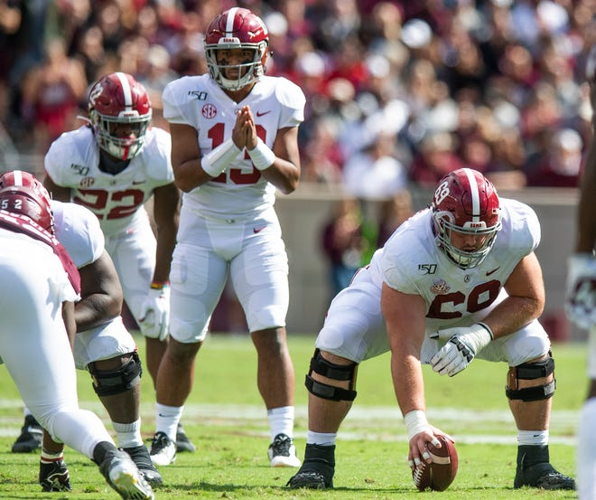 Alabama center Landon Dickerson (69) with quarterback Tua Tagovailoa (13) against Texas A&M at Kyle Field in College Station, Texas on Saturday October 12, 2019.