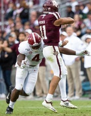 Alabama linebacker Christopher Allen (4) hits Texas A&M quarterback Kellen Mond (11) at Kyle Field in College Station, Texas on Saturday October 12, 2019.