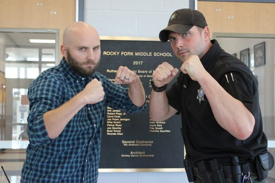 Assistant Principal Alan Davis, left, and SRO Chris Erwin of Rocky Fork Middle School prepare to tangle with professional wrestlers Chris Michaels and Damien Wayne at 7 p.m. Saturday at the school.
