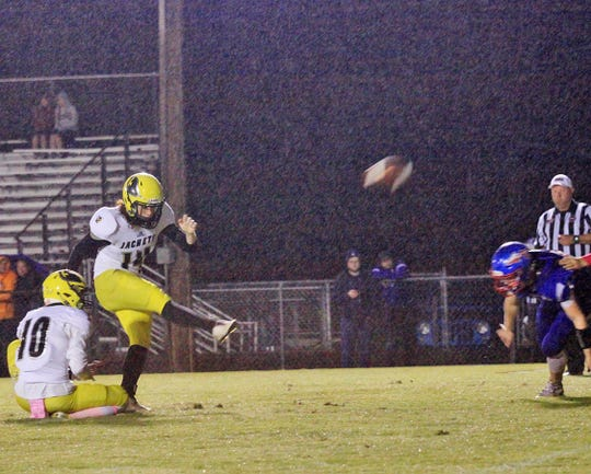 Fairview Kicker #14 Skyler Wilson scores extra points after all the Jacket's touchdowns despite constant rain the entire game against the Harpeth Indians October 11, 2019.