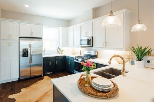 Kitchens in 2Aves are well equipped. Buyers are able to add custom features to the interiors of their townhomes.