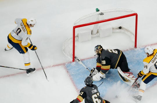 Nashville Predators left wing Filip Forsberg (9) scores against Vegas Golden Knights goaltender Marc-Andre Fleury (29) during the second period of an NHL hockey game Tuesday, Oct. 15, 2019, in Las Vegas. (AP Photo/John Locher)