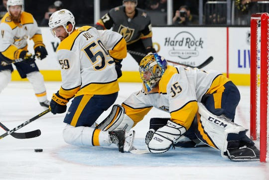 Nashville Predators goaltender Pekka Rinne (35) and defenseman Roman Josi (59) keep the puck away from the net during the second period of the team's NHL hockey game against the Vegas Golden Knights, Tuesday, Oct. 15, 2019, in Las Vegas. (AP Photo/John Locher)