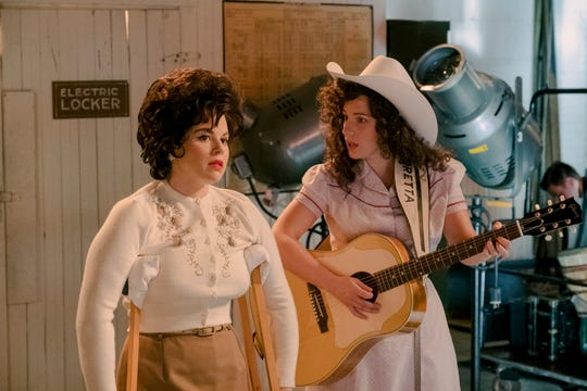 """This image released by Lifetime shows Jessie Mueller as Loretta Lynn, right, and Megan Hilty as Patsy Cline in a scene from the TV film """"Patsy & Loretta."""" The film airs on Oct. 19 on Lifetime."""