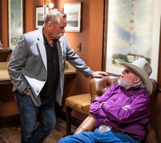 David Corlew, left, chats with Charlie Daniels backstage at the Grand Ole Opry House Tuesday, October 15, 2019.