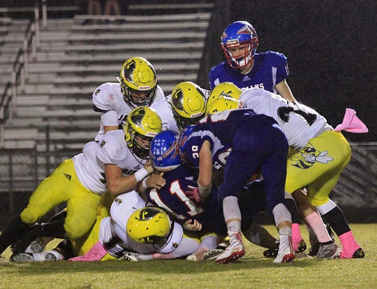 With a group effort, the Fairview Jacket's defensive line sacks the Harpeth Indian's Quarterback for a loss of yards on October 11, 2019.