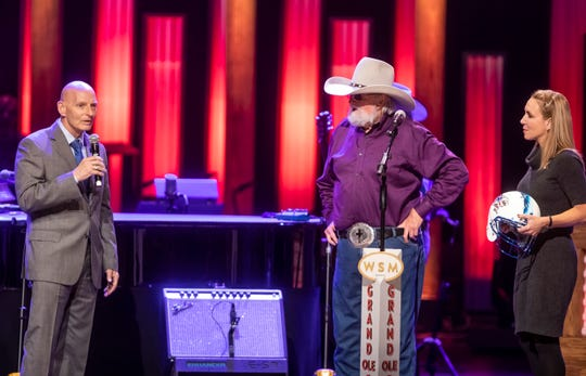 Charlie Daniels is recognized for his involvement with the Charlie and Hazel Daniels Veterans and Military Family Centerat MTSU during his performance at the Grand Ole Opry House Tuesday, Oct. 15, 2019. Also pictured are retired Army Lt. Gen. Keith Huber, left, and center Director Hillary Miller, right.