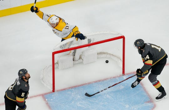 Nashville Predators' Nick Bonino (13) celebrates after Colton Scored scored against the Vegas Golden Knights during the second period of an NHL hockey game Tuesday, Oct. 15, 2019, in Las Vegas. Bonino had an assist on the goal. (AP Photo/John Locher)