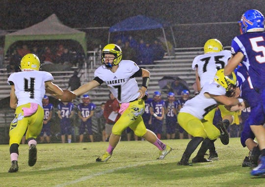 Fairview Quarterback #7 Anakin King makes nice hand off to Running Back #4 Riley Bennett with the great blocking by the Jacket's offensive line against the Harpeth Indians on October 11, 2019.