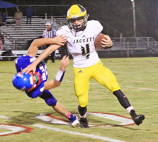 Fairview Running Back #4 Riley Bennett avoids this tackle by Harpeth for a Jacket's first down.