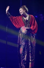 "Lauren Daigle accepts Song of the Year for ""You Say"" at the Gospel Music Association (GMA) 50th Annual Dove Awards at Lipscomb University's Allen Arena Tuesday, Oct. 15, 2019, in Nashville, Tenn."