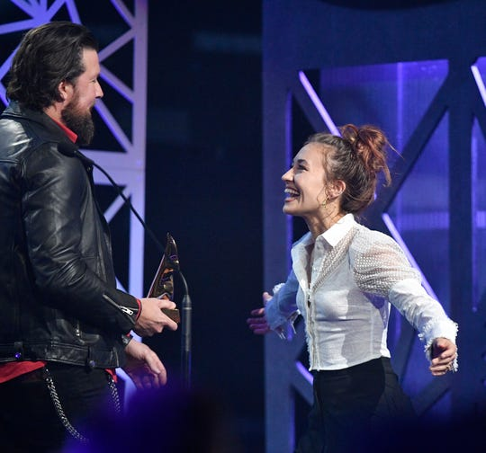 Lauren Daigle prepares to hug Zack Williams as she accepts her Artist of the Year award at the Dove Awards on Tuesday.