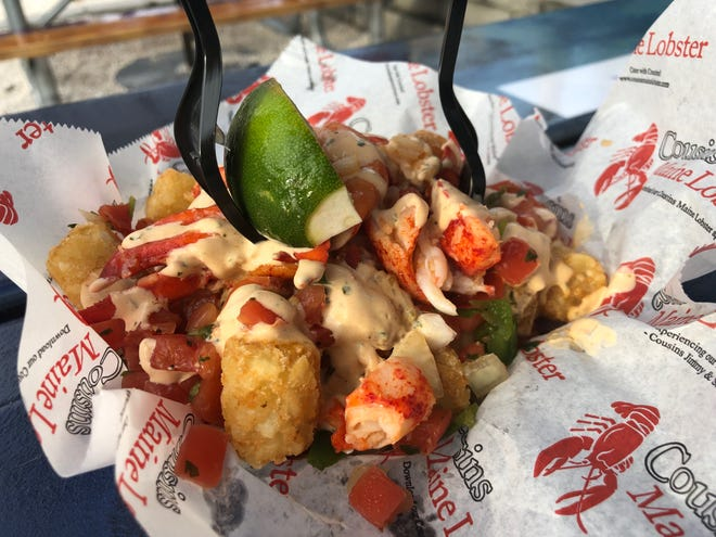 Cousin Maine Lobster's lobster tots ($14.75) feature tater tots served with warmed lobster, cilantro lime sauce and pico de gallo.