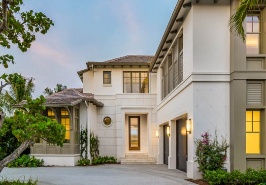 Custom estate at 4395 Gordon Drive showcases the endless possibilities for enjoying scenic views along the water with a coastal-contemporary interior design by Romanza Interior Design.