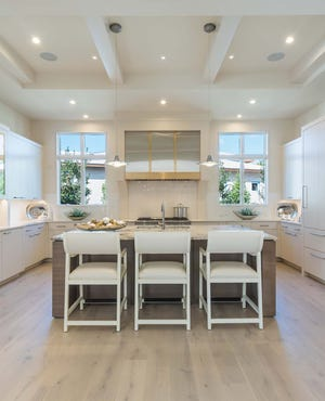 The sophisticated, streamlined design of the Bianca kitchen featuring interiors by Romanza Interior Design received top honors for best kitchen.