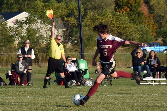 Licking Heights junior Alex Roth shoots on Westerville South's goal during Tuesday night's Division I first-round match. Roth's ball found the net, but the goal was called back for an offsides penalty. The Hornets won 3-1.
