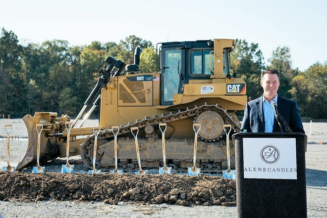 Rod Harl, president of Alene Candles, greets attendees at Tuesday's groundbreaking event.