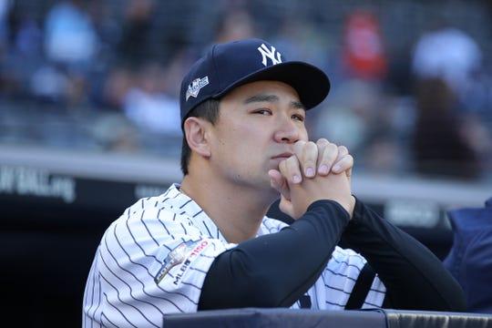 Oct 15, 2019; Bronx, NY, USA; New York Yankees starting pitcher Masahiro Tanaka (19) looks on before game three of the 2019 ALCS playoff baseball series against the Houston Astros at Yankee Stadium.