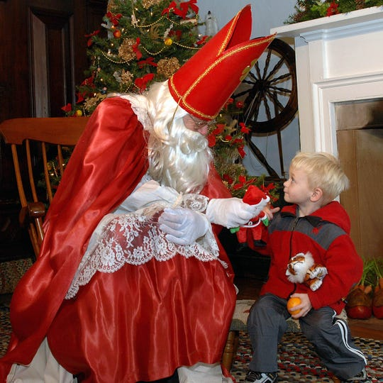 Louis Treboski, 3, of Wyckoff speaks with Sinterklaas, who visited the Garretson Homestead in Bergen County on December 10th. Based on fact, St. Nicholas lived from 271 AD to 342 AD.  Dutch children believe that he spend his year recording the behavior of children and on December 5th leaves gifts for the good little boys and girls in their wooden shoes.