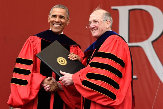President Barack Obama receives an honoree Doctor of Laws degree from Rutgers President Robert Barchi. President Obama delivers the  commencement address at Rutgers University graduation on May 15, 2016.