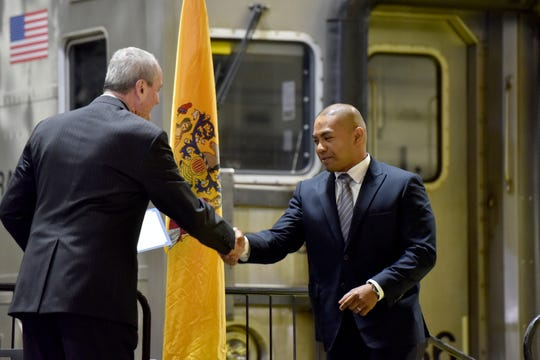 Governor Murphy presents a certificate of appreciation to Warlito Caronan of Bloomfield, an engineer trainee, during a Completion of Classroom Training Ceremony for seven NJ TRANSIT trainees on October 15, 2019 in Kearny.