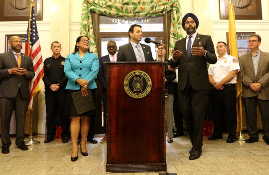 Paterson Mayor, André Sayegh and New Jersey Attorney General, Gurbir Singh Grewal, are shown at a press conference. The attorney general announced grant funding to pilot an opoid abuse program in Paterson.  Part of the funding will create an Opioid Response Team. Wednesday, October 16, 2019