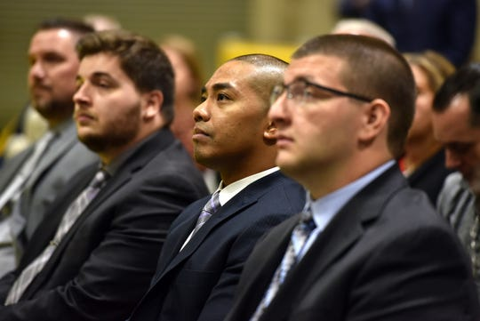 NJ Transit engineer trainee Warlito Caronan of Bloomfield listens to Governor Murphy delivers remarks prior to handing out certificates of appreciation at the Completion of Classroom Training Ceremony for seven NJ TRANSIT engineer trainees on October 15, 2019 in Kearny.