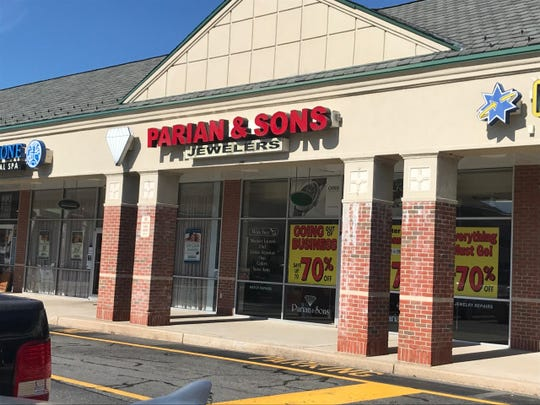 The storefront for Parian & Sons announces their closeout sale in the Franklin Crossing Mall in Franklin Lakes