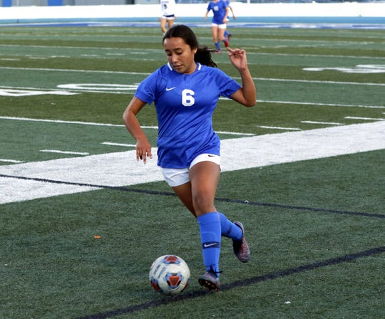 Carlsbad's Dominique Chacon tightropes the out of bounds area looking for a teammate to pass to in the first half of the Clovis match on Oct. 15, 2019. Carlsbad won in double overtime, 1-0.